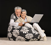 Fashionable elderly couple in studio Stock Photo