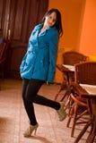 Fashionable elegant brunette in cafe Stock Image