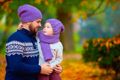 Fashionable father and son talking in autumn park Stock Image