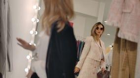 Fashionable female friends enjoying shopping in boutique.