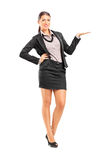 Fashionable female gesturing with hand Stock Images