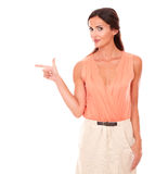 Fashionable female pointing to her right Stock Photo