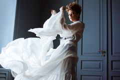 Fashionable female portrait of cute lady in dress indoors Royalty Free Stock Photo