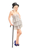 Fashionable female with retro hat and a cane Royalty Free Stock Photography