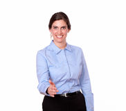 Fashionable female standing with greeting gesture Royalty Free Stock Image