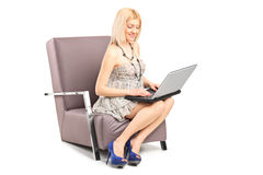 Fashionable female working on a laptop Stock Image