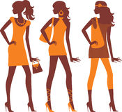 Fashionable females silhouettes. Three female silhouettes in different clothes Stock Image