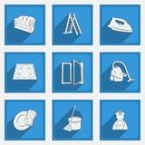 Fashionable flat icons with long shadows cleaning theme on a blue background. Stock Photos