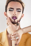 Fashionable gay model with beard and magenta makeup Royalty Free Stock Photography