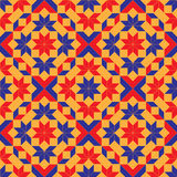 Fashionable geometric seamless pattern with rhombus, square, triangle and star shapes of blue, red and orange shades. Abstract fashionable geometric seamless Royalty Free Stock Photography
