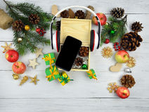 Fashionable gift for the holidays: the smart phone and headphone Stock Photo