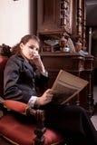 Fashionable girl in antique shop Stock Photos