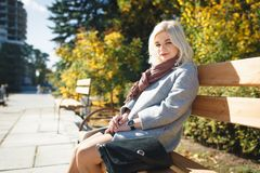 Girl is walking in the park, a fashionable girl on an autumn wal Stock Photography