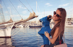 Fashionable girl in a beautiful harbor Royalty Free Stock Photos