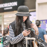 Fashionable girl, Beijing downtown, China. BEIJING-MAY 21, 2016. Fashionable girl with smartphone. China mobile internet market will exceed US$717 billion in stock image