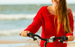 Fashionable girl with bike outdoor. Young active girl with bicycle on seaside. Smiling cute woman resting near to sea in summer. Fashionable tourist on fresh Stock Photo