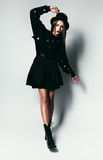 Fashionable girl in black dress and boots Royalty Free Stock Photo