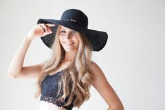 Fashionable girl blonde with blue eyes in a hat with a brim. 1 stock images