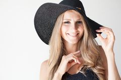 Fashionable girl blonde with blue eyes in a hat with a brim. 1 Stock Image