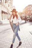 Fashionable girl in the city in the sun. bright image of city life royalty free stock photos
