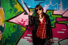 Fashionable girl and colorful graffiti wall Royalty Free Stock Photography
