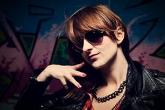 Fashionable girl and colorful graffiti wall Royalty Free Stock Photo