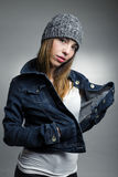 Fashionable girl in denim jacket Stock Images