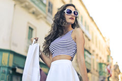 Fashionable girl doing shopping Royalty Free Stock Photography