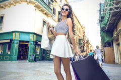 Fashionable girl doing shopping Royalty Free Stock Photography