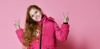 Fashionable girl in down jacket royalty free stock photography