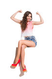 Fashionable Girl Flexing Muscles Stock Image