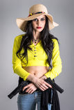 Fashionable girl with guns Royalty Free Stock Images