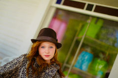 Fashionable girl in hat. Portrait of fashionable young girl in trendy, trilby style hat outdoors Royalty Free Stock Photos