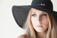 Fashionable girl in a hat with a brim poses for advertising. 1 stock photos