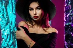Fashionable girl in hat with wide brim. Looking at the camera in studio with green eyes royalty free stock photos