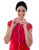 Fashionable girl with headphones Royalty Free Stock Photos