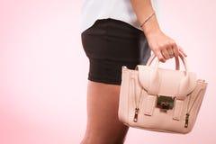 Fashionable girl holding bag handbag. Stock Photos