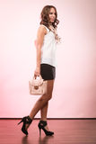 Fashionable girl holding bag handbag. Royalty Free Stock Images