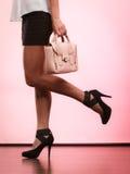 Fashionable girl holding bag handbag. Royalty Free Stock Photos