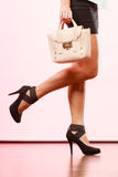 Fashionable girl holding bag handbag. Royalty Free Stock Photography