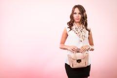 Fashionable girl holding bag handbag. Royalty Free Stock Photography