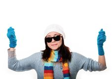 Fashionable girl in a knitted hat and sunglasses smiling and hol Royalty Free Stock Photos
