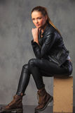 Fashionable girl in leather posing in studio background Stock Photo