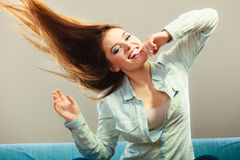 Fashionable girl with long hair blowing Royalty Free Stock Photos