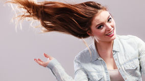 Fashionable girl with long hair blowing Royalty Free Stock Image