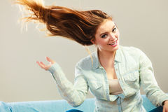 Fashionable girl with long hair blowing Royalty Free Stock Images