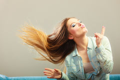 Fashionable girl with long hair blowing Stock Photos