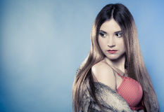Fashionable girl with long hair in fur coat Royalty Free Stock Photo