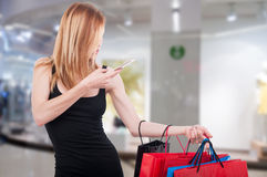 Fashionable girl in the mall with shopping bags Royalty Free Stock Image
