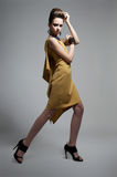 Fashionable girl in modern dress posing Royalty Free Stock Photos